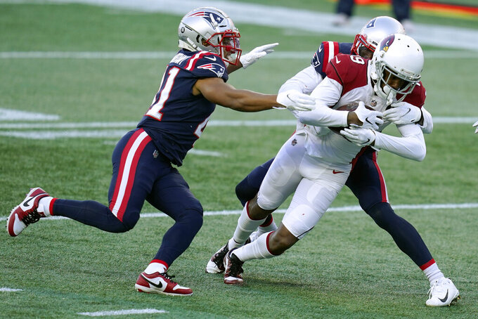 New England Patriots cornerback Jason McCourty, rear, tackles Arizona Cardinals wide receiver KeeSean Johnson short of the goal line near the end fo the first half of an NFL football game, Sunday, Nov. 29, 2020, in Foxborough, Mass. (AP Photo/Charles Krupa)
