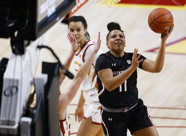 South Carolina guard Destiny Littleton finds a shot around Iowa State's defense during the first half of an NCAA college basketball game, Sunday, Dec. 6, 2020, in Ames, Iowa. (AP Photo/ Matthew Putney)