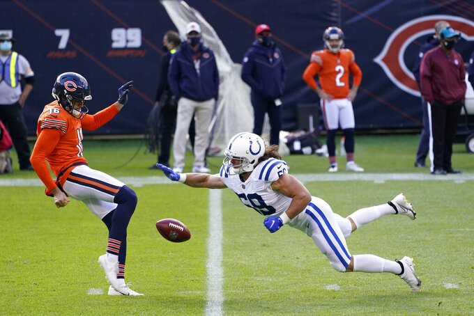 Indianapolis Colts linebacker Jordan Glasgow (59) tips the punt of Chicago Bears punter Pat O'Donnell (16) during the first half of an NFL football game, Sunday, Oct. 4, 2020, in Chicago. (AP Photo/Charles Rex Arbogast)