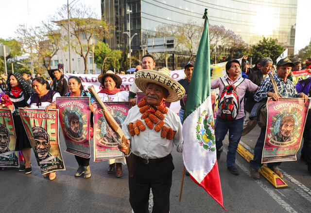 Farm workers and activists march in Mexico City, Friday, Feb. 21, 2020. Demonstrators are protesting Mexican President Andres Manuel Lopez Obrador's infrastructure projects, including a thermoelectric plant in Morelos state and the