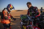 Ricky Brabec of United States, right, talks with Toby Price of Australia before the start of stage twelve of the Dakar Rally between Haradth and Qiddiya, Saudi Arabia, Friday, Jan. 17, 2020. (AP Photo/Bernat Armangue)