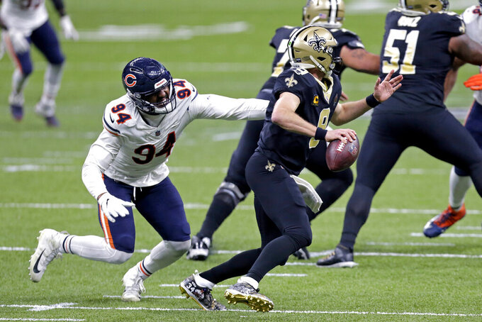 New Orleans Saints quarterback Drew Brees (9) scrambles under pressure from Chicago Bears outside linebacker Robert Quinn (94) in the first half of an NFL wild-card playoff football game in New Orleans, Sunday, Jan. 10, 2021. (AP Photo/Brett Duke)