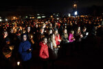 People gather for a candlelight vigil for the Haynie family at City Park in Grantsville, Utah, Monday, Jan. 20, 2020. Police say four members of the Haynie family were killed and one injured after being shot by a teenage family member on Jan. 17. (Spenser Heaps/The Deseret News via AP)