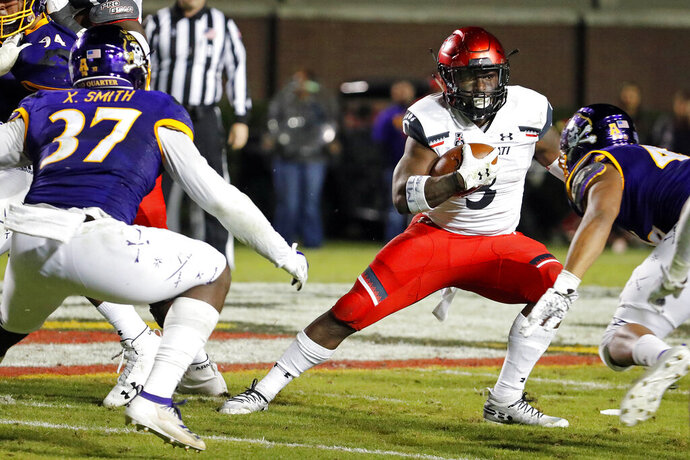 Cincinnati's Michael Warren II (3) avoids a tackle by East Carolina's Xavier Smith (37) during the second half of an NCAA college football game in Greenville, N.C., Saturday, Nov. 2, 2019. (AP Photo/Karl B DeBlaker)