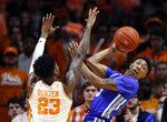 Memphis guard Boogie Ellis (5) passes the ball off as he's defended by Tennessee guard Jordan Bowden (23) during the first half of an NCAA college basketball game Saturday, Dec. 14, 2019, in Knoxville, Tenn. (AP Photo/Wade Payne)