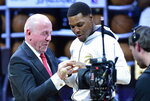 Toronto Raptors guard Kyle Lowry receives his 2019 NBA basketball championship ring from Larry Tanenbaum, chairman of Maple Leaf Sports & Entertainment, before the Raptors played the New Orleans Pelicans in Toronto on Tuesday Oct. 22, 2019. (Frank Gunn/The Canadian Press via AP)