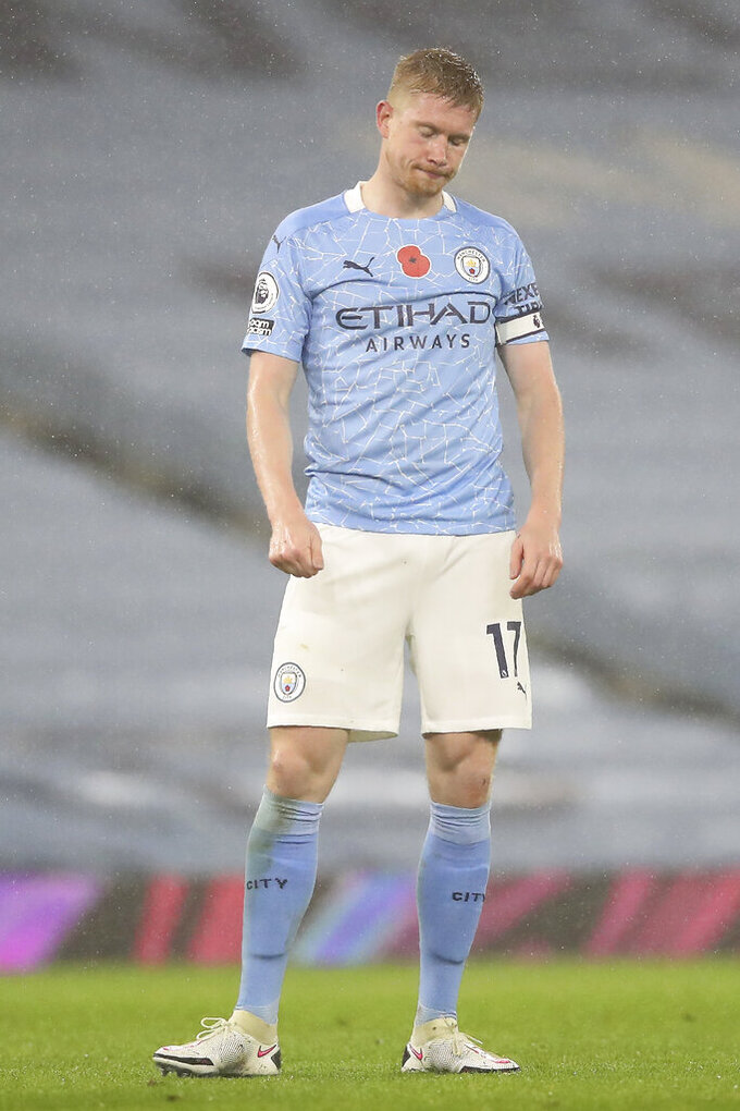 Manchester City's Kevin De Bruyne reacts during the English Premier League soccer match between Manchester City and Liverpool at the Etihad stadium in Manchester, England, Sunday, Nov. 8, 2020. (Martin Rickett/Pool via AP)