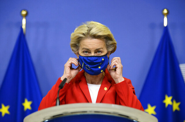 European Commission President Ursula von der Leyen, takes off her protective mask prior to making a statement regarding the Withdrawal Agreement at EU headquarters in Brussels, Thursday, Oct. 1, 2020. The European Union took legal action against Britain on Thursday over its plans to pass legislation that would breach parts of the legally binding divorce agreement the two sides reached late last year. (Johanna Geron, Pool via AP)