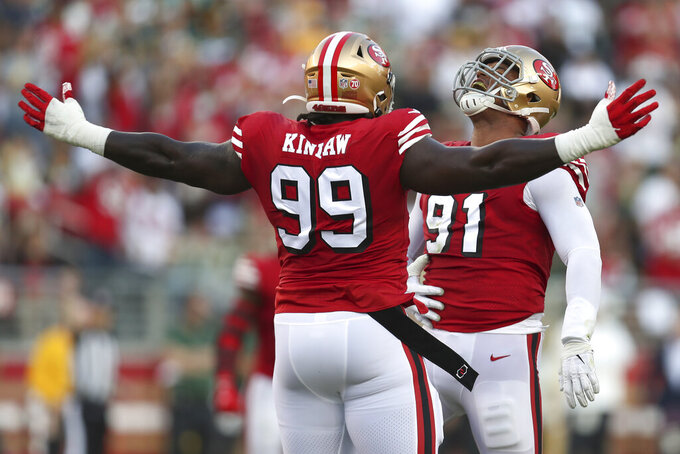 San Francisco 49ers defensive end Arik Armstead (91) celebrates after sacking Green Bay Packers quarterback Aaron Rodgers with defensive tackle Javon Kinlaw (99) during the first half of an NFL football game in Santa Clara, Calif., Sunday, Sept. 26, 2021. (AP Photo/Jed Jacobsohn)