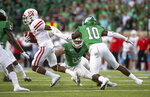 North Texas's Nate Durham (29) and Makyle Sanders (10) attempt to take down Houston wide receiver Bryson Smith (1) during the first half of an NCAA college football game on Saturday, Sept. 28, 2019, in Denton, Texas.  (Kara Dry/The Denton Record-Chronicle via AP)