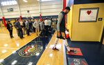 New Orleans Pelicans forward Anthony Davis leaves the court after talking to reporters after their NBA basketball practice in Metairie, La., Friday, Feb. 1, 2019. (AP Photo/Gerald Herbert)