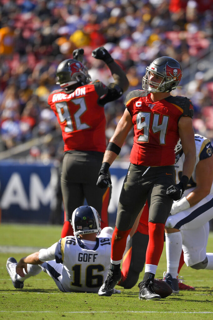 Tampa Bay Buccaneers linebacker Carl Nassib (94) and defensive tackle William Gholston (92) celebrate after sacking Los Angeles Rams quarterback Jared Goff during the second of an NFL football game Sunday, Sept. 29, 2019, in Los Angeles. (AP Photo/Mark J. Terrill)
