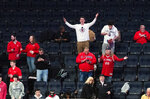 Fans react after the NCAA college basketball game between St. John's and Creighton in the quarterfinal of the Big East men's tournament was canceled at halftime Thursday, March 12, 2020, at Madison Square Garden in New York. (AP Photo/Mary Altaffer)