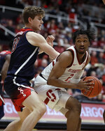 Arizona's Stone Gettings, left, defends against Stanford's Bryce Wills during the first half of an NCAA college basketball game Saturday, Feb. 15, 2020, in Stanford, Calif. (AP Photo/Ben Margot)