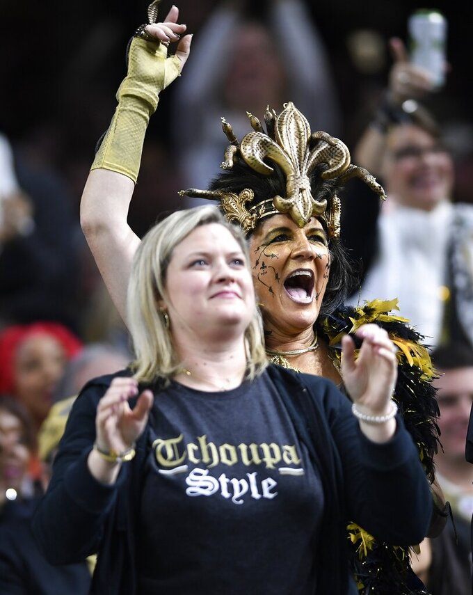 New Orleans Saints fan cheer in the second half of an NFL divisional playoff football game against the Philadelphia Eagles, in New Orleans, Sunday, Jan. 13, 2019. (AP Photo/Bill Feig)