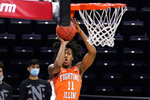 FILE - Illinois guard Ayo Dosunmu shoots during the first half of the team's NCAA college basketball game against Northwestern in Evanston, Ill., in this Thursday, Jan. 7, 2021, file photo. Dosunmu has made The Associated Press All-America first team, announced Tuesday, March 16, 2021.  (AP Photo/Nam Y. Huh, File)