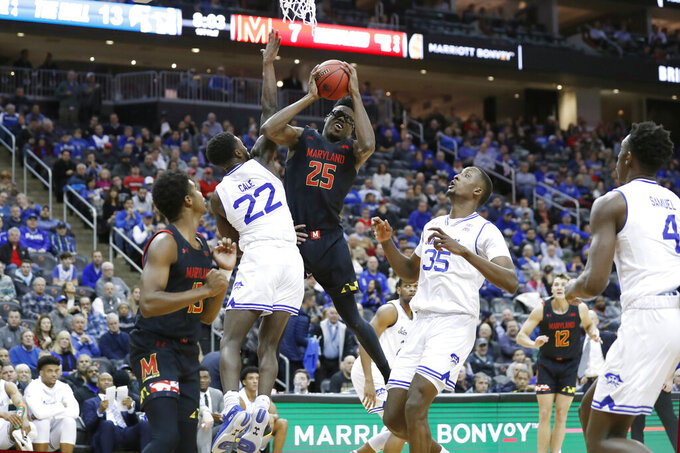 Seton Hall guard Myles Cale (22) blocks Maryland forward Jalen Smith (25) with Seton Hall center Romaro Gill (35) looking on during the first half of an NCAA college basketball game, Thursday, Dec. 19, 2019, in Newark, N.J. (AP Photo/Kathy Willens)