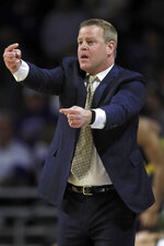 Marquette head coach Steve Wojciechowski calls for a switch during the first half of an NCAA college basketball game against Kansas State in Manhattan, Kan., Saturday, Dec. 7, 2019. (AP Photo/Orlin Wagner)