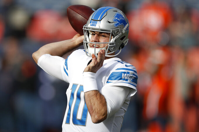 Detroit Lions quarterback David Blough warms up prior to an NFL football game against the Denver Broncos, Sunday, Dec. 22, 2019, in Denver. (AP Photo/David Zalubowski)
