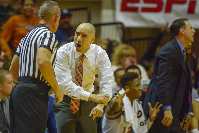 Texas Longhorns head coach Shaka Smart reacts to a referee during the first half of an NCAA college basketball game in Morgantown, W.Va. on Saturday Feb. 9, 2019. (AP Photo/Craig Hudson)