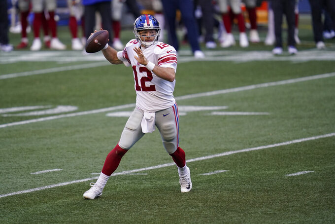 New York Giants quarterback Colt McCoy passes against the Seattle Seahawks during the second half of an NFL football game, Sunday, Dec. 6, 2020, in Seattle. (AP Photo/Elaine Thompson)
