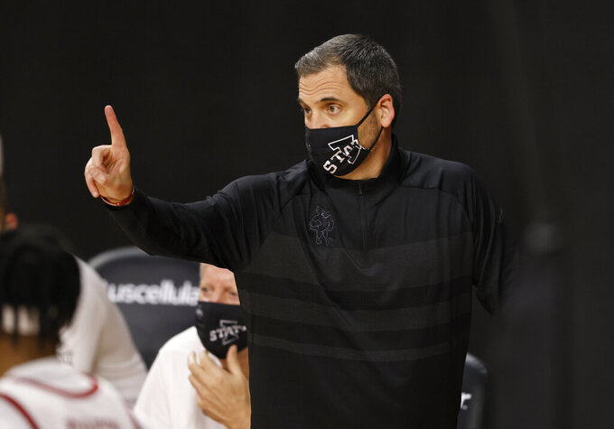 Iowa State head coach Steve Prohm directs his players against Arkansas-Pine Bluff during the second half of an NCAA college basketball game, Sunday, Nov. 29, 2020, in Ames, Iowa. (AP Photo/Matthew Putney)