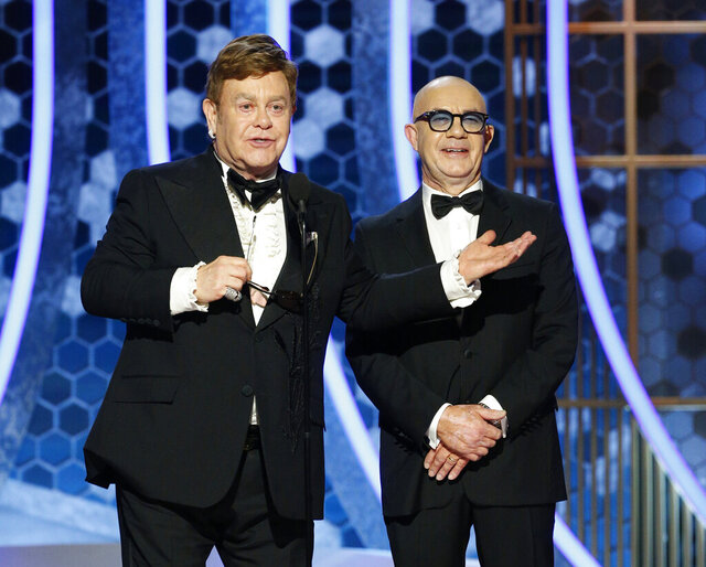 This image released by NBC shows presenters Elton John, left, and Bernie Taupin at the 77th Annual Golden Globe Awards at the Beverly Hilton Hotel in Beverly Hills, Calif., on Sunday, Jan. 5, 2020. (Paul Drinkwater/NBC via AP)