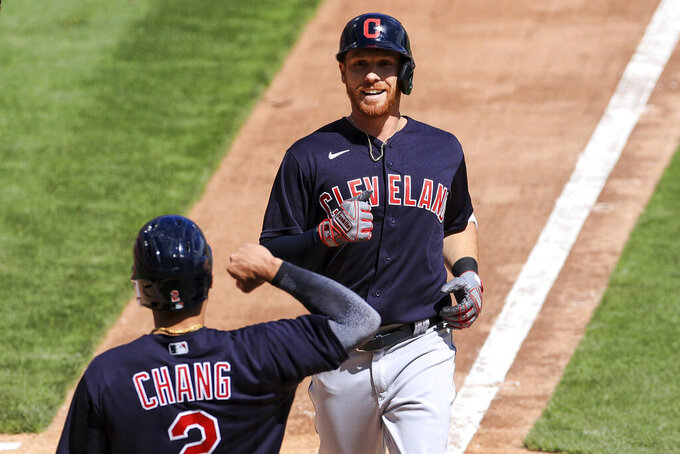 Cleveland Indians' Jordan Luplow reacts with teammate Yu Chang after hitting a two-run home run during the seventh inning of a baseball game against the Cincinnati Reds in Cincinnati, Sunday, April 18, 2021. (AP Photo/Aaron Doster)