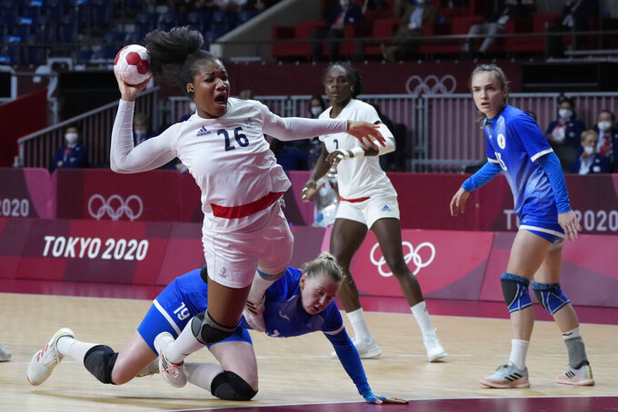 France's Pauletta Foppa scores a goal during the women's gold medal handball match between the Russian Olympic Committee and France at the 2020 Summer Olympics, Sunday, Aug. 8, 2021, in Tokyo, Japan. (AP Photo/Sergei Grits)