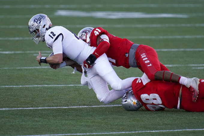 New Mexico linebacker Dion Hunter (41) sacks Nevada quarterback Carson Strong (12) during the first half of an NCAA college football game Saturday, Nov. 14, 2020, in Las Vegas. (AP Photo/John Locher)