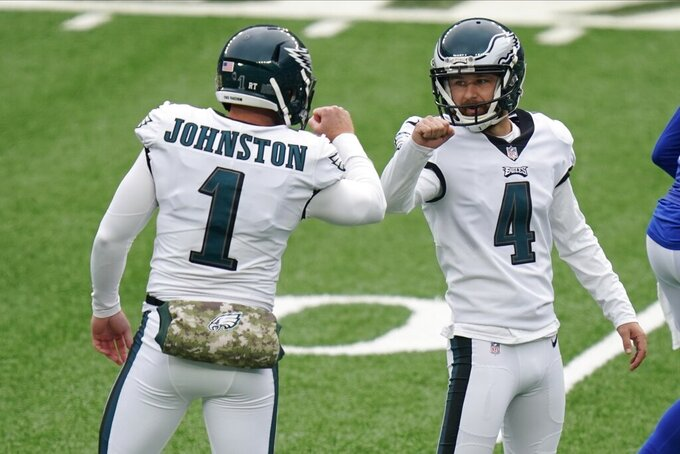 Philadelphia Eagles' Jake Elliott (4) celebrates with Cameron Johnston (1) after kicking a field goal during the first half of an NFL football game against the New York Giants, Sunday, Nov. 15, 2020, in East Rutherford, N.J. (AP Photo/Seth Wenig)