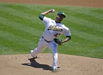 Oakland Athletics pitcher Frankie Montas works against the Colorado Rockies in the first inning of a baseball game Wednesday, July 29, 2020, in Oakland, Calif. (AP Photo/Ben Margot)