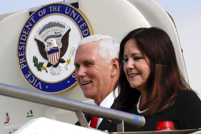 FILE - In this Jan. 24, 2020 file photo, Vice President Mike Pence and his wife Karen disembark from Air Force Two upon their arrival at Rome's Ciampino airport. Karen Pence says it's OK to not be OK during the coronavirus pandemic.  While Vice President Mike Pence runs the White House coronavirus task force, his wife is leading a parallel effort to help people deal with anxiety and other unsettling emotions brought on by the pandemic.(AP Photo/Alessandra Tarantino)