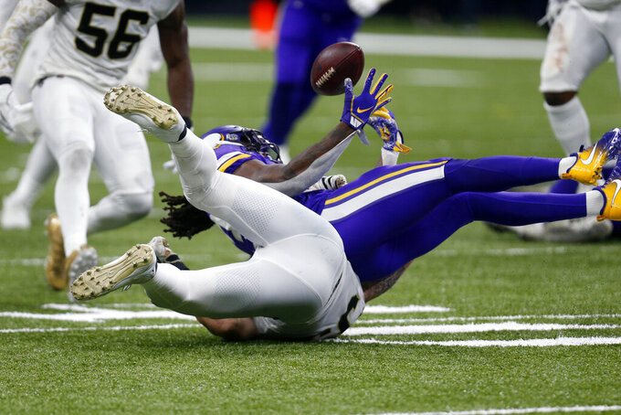 Minnesota Vikings running back Dalvin Cook loses the ball as he is tackled by New Orleans Saints outside linebacker A.J. Klein in the second half of an NFL wild-card playoff football game, Sunday, Jan. 5, 2020, in New Orleans. The Saints returned the ball to their end zone but he was ruled down by contact on the play, maintaining possession. (AP Photo/Butch Dill)