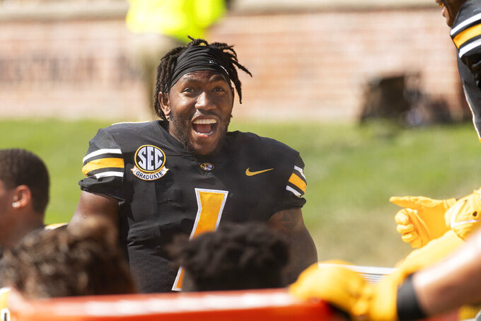 Missouri running back Tyler Badie laughs with teammates on the bench after he scored a touchdown during the first quarter of an NCAA college football game against Southeast Missouri State, Saturday, Sept. 18, 2021, in Columbia, Mo. (AP Photo/L.G. Patterson)