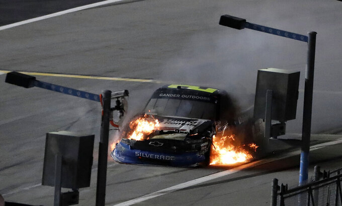 Sheldon Creed's truck burns after crashing during the NASCAR Truck Series auto race Friday, Feb. 15, 2019, at Daytona International Speedway in Daytona Beach, Fla. (AP Photo/Chris O'Meara)