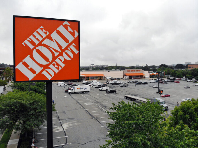 FILE - In this Aug. 14, 2018 file photo shows a Home Depot store in Passaic, N.J. Home Depot is reporting better than expected profit and revenue for the first quarter, though bad weather early in the year and an extra week in the fiscal year dampened the home improvement retailer's comparable store sales. Those sales, watched closely by industry analysts, rose 2.5%, short of the 4.2% they were expecting, according to a survey by Zacks Investment Research. (AP Photo/Ted Shaffrey, File)