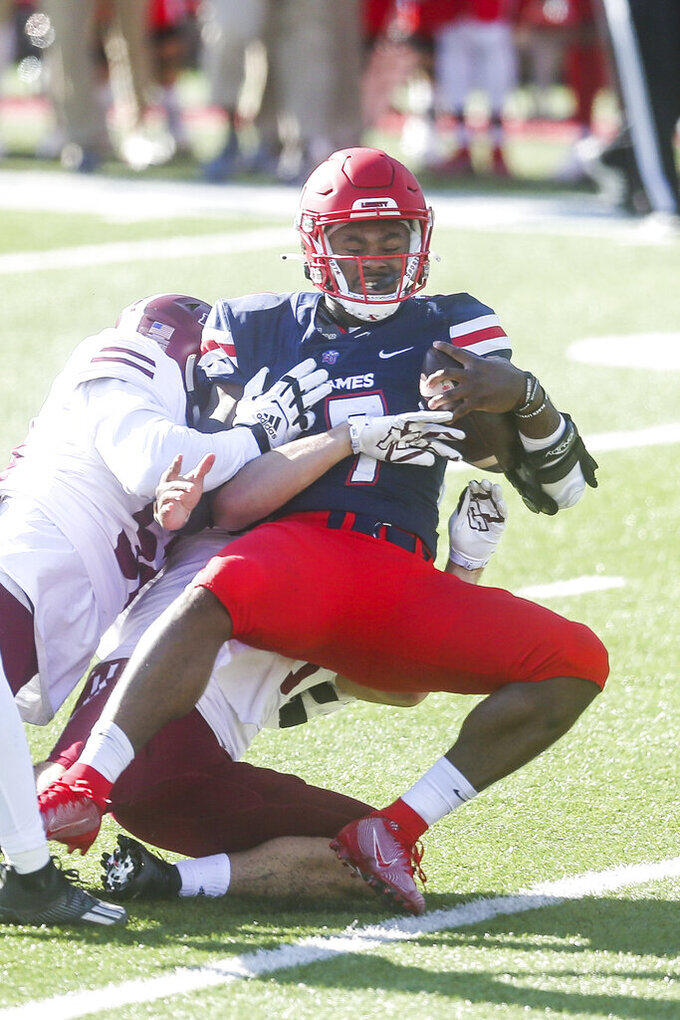 Liberty quarterback Malik Willis (7) gets sacked during the first half of a NCAA college football game against Massachusetts on Friday, Nov. 27, 2020, at Williams Stadium in Lynchburg, Va. (AP Photo/Shaban Athuman)