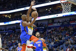 Oklahoma City Thunder guard Chris Paul (3) goes up for a basket against New Orleans Pelicans center Derrick Favors (22) during the first half of an NBA basketball game in New Orleans, Thursday, Feb. 13, 2020. (AP Photo/Matthew Hinton)