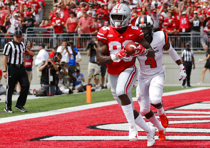 Ohio State receiver Terry McLaurin catches a touchdown pass in front of Oregon State defensive back Dwayne Williams during the first half of an NCAA college football game Saturday, Sept. 1, 2018, in Columbus, Ohio. (AP Photo/Jay LaPrete)