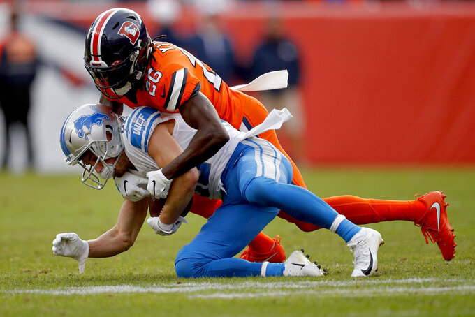 Detroit Lions quarterback David Blough, bottom, is sacked by Denver Broncos cornerback Isaac Yiadom during the first half of an NFL football game, Sunday, Dec. 22, 2019, in Denver. (AP Photo/David Zalubowski)