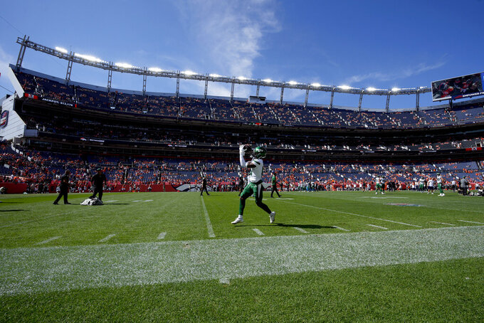 New York Jets running back Ty Johnson warms up prior to an NFL football game against the Denver Broncos, Sunday, Sept. 26, 2021, in Denver. (AP Photo/David Zalubowski)
