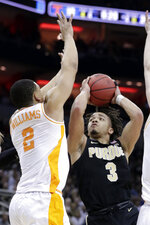 Purdue's Carsen Edwards (3) shoots against Tennessee's Grant Williams (2) during the first half of a men's NCAA Tournament college basketball South Regional semifinal game, Thursday, March 28, 2019, in Louisville, Ky. (AP Photo/Michael Conroy)