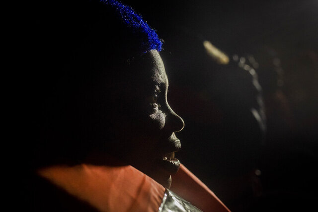 Wealth Peter, from Nigeria, reacts after being rescued from an overcrowded rubber boat in the Mediterranean Sea, by aid workers of the Spanish NGO Open Arms, international waters, off the Libyan coast, Friday, Jan. 10, 2020. (AP Photo/Santi Palacios)