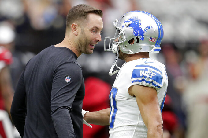 Arizona Cardinals head coach Kliff Kingsbury talks with Detroit Lions wide receiver Danny Amendola prior to an NFL football game, Sunday, Sept. 8, 2019, in Glendale, Ariz. (AP Photo/Darryl Webb)