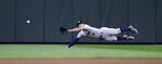 Houston Astros center fielder Jake Marisnick dives for a single from Seattle Mariners' Austin Nola during the ninth inning of a baseball game Wednesday, Sept. 25, 2019, in Seattle. The single was the first hit of the game for the Mariners. The Astros won 3-0. (AP Photo/Elaine Thompson)