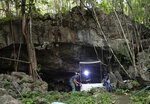 Researchers set up equipment for catch bat in front of cave inside Sai Yok National Park in Kanchanaburi province, west of Bangkok, Thailand, Friday, July 31, 2020. Researchers in Thailand have been trekking though the countryside to catch bats in their caves in an effort to trace the murky origins of the coronavirus.(AP Photo/Sakchai Lalit)