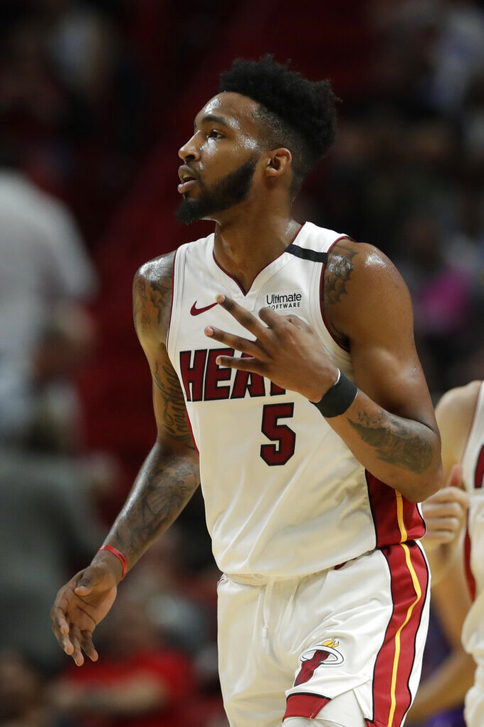 Miami Heat forward Derrick Jones Jr. (5) celebrates a three-point shot during the first half of an NBA basketball game against the Charlotte Hornets, Wednesday, March 11, 2020, in Miami. (AP Photo/Wilfredo Lee)