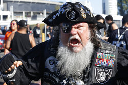 "An Oakland Raiders fan who calls himself ""Captain Jack Rack'em,"" from Tampa, Fla., tailgates before the start of an NFL football game between the Oakland Raiders and the Denver Broncos Monday, Sept. 9, 2019, in Oakland, Calif. (AP Photo/D. Ross Cameron)"