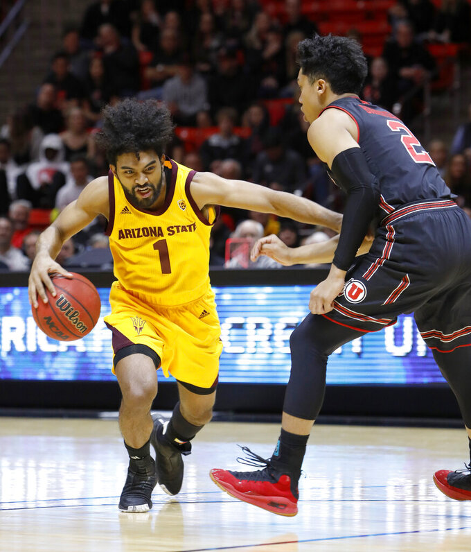 Arizona State's Remy Martin (1) dribbles past Utah's Sedrick Barefield (2) during the first half of an NCAA college basketball game Saturday, Feb. 16, 2019, in Salt Lake City. (AP Photo/Kim Raff)